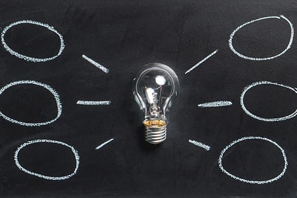 lightbulb on chalkboard with chalk diagram